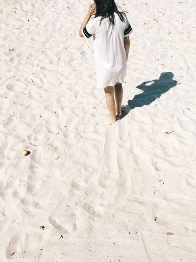 Sand Rear View One Person Low Section Sunlight Full Length Leisure Activity Lifestyles Outdoors One Woman Only Day Vacations Real People Young Adult One Young Woman Only Adults Only Beach Only Women White Minimalistic Minimalism