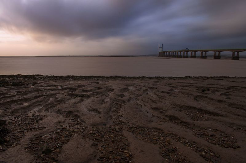 Long Exposure Severn Bridge Bridge - Man Made Structure Sky Cloud - Sky Sea Nature Beauty In Nature Beach Water Sunset Sand Scenics Horizon Over Water Built Structure Tranquility Architecture Storm Cloud Outdoors No People