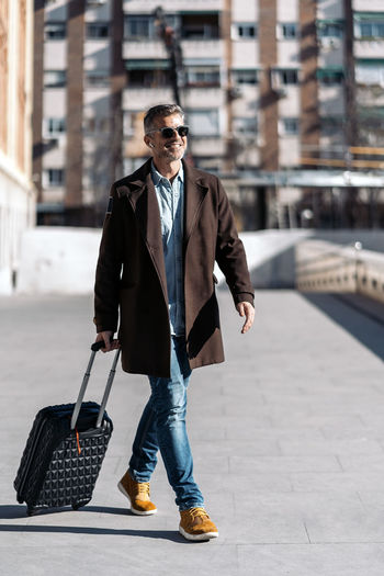 Full length of a young man walking in city