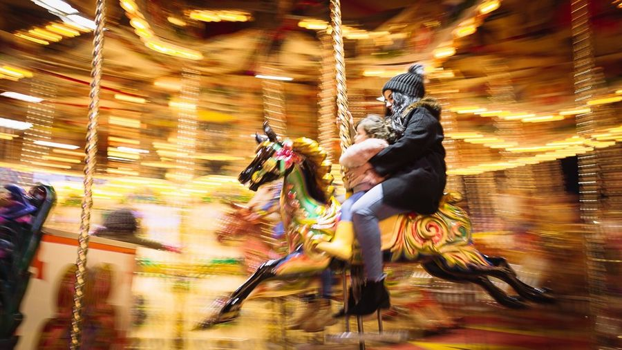 Blurred motion of person riding horses