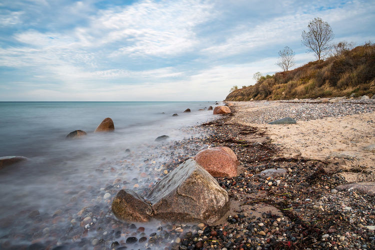 Stones on shore of the Baltic Sea in Elmenhorst, Germany. Water Sea Beauty In Nature Scenics - Nature Beach Nature Day Rock Landscape Stones Baltic Sea Coast Shore Elmenhorst Rostock Mecklenburg-Vorpommern Travel Destinations Travel Vacation Tourism Relaxing Trees Cloud - Sky Sky And Clouds Long Exposure