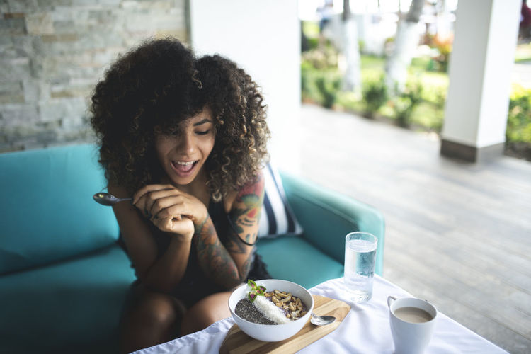 Adult Coffee Coffee - Drink Coffee Cup Cup Drink Emotion Food And Drink Hair Hairstyle Lifestyles Mug Real People Refreshment Sitting Smiling Table Two People Wireless Technology Women Young Adult Young Women