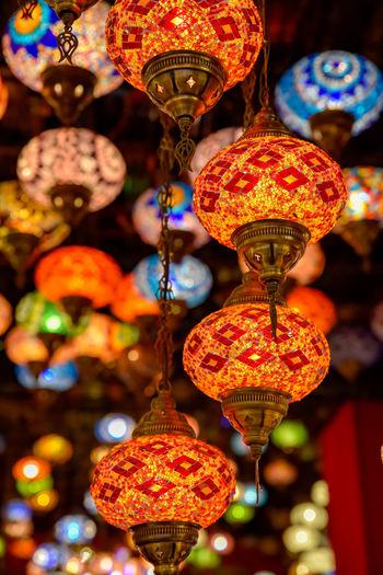 Close-up of illuminated lanterns hanging at night