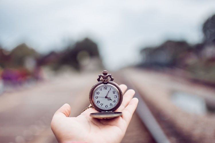 Human Hand Hand Human Body Part Holding One Person Time Clock Watch Focus On Foreground Instrument Of Time Day Body Part Close-up Clock Face Unrecognizable Person Minute Hand Real People Finger Human Finger Pocket Watch Antique Checking The Time Stopwatch Vintage
