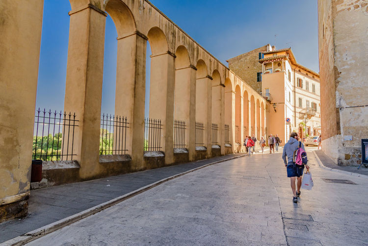Architectural columns by footpath at palazzo orsini