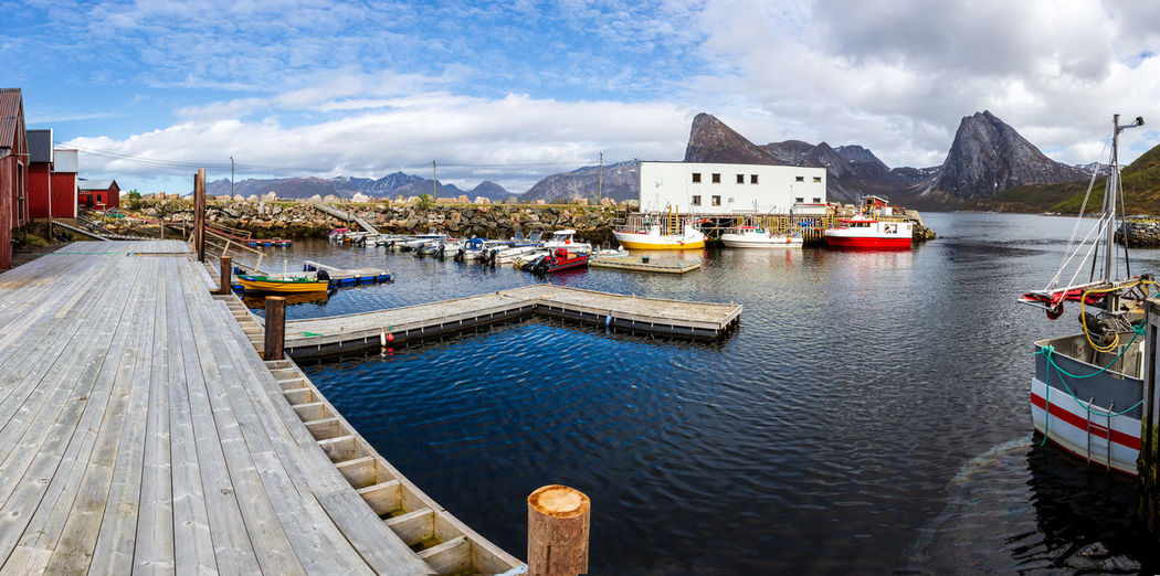landscape view of Senja Island in Norway Barents Sea, Northern, Senja Island, Arctic, Atlantic, Coast, Cold, Europe, Fishing, Fjord, Harbor, Holiday, Ice, Landscape, Mountains, Nature, Nordic, North, North Sea, Norway, Norwegian, Ocean, Outdoor, Polar Circle, Port, Scandinavia, Sea, Seascape, Sky, Spring, Summer, Tourism, Travel, Village, Water Water Nautical Vessel Transportation Mode Of Transportation Cloud - Sky Sky Architecture Built Structure Building Exterior Nature Day Mountain Sea Moored Travel No People City Outdoors Harbor Sailboat Passenger Craft Yacht