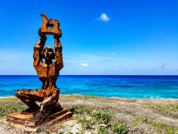 Horizon Over Water Sky Water Blue Outdoors Day No People Nature Sculpture Grass Metal Rust Blue Water Ocean Waves Trapical Climate Isla Mujeres Mexico Mexico Springtime May 2017 Spring Horizon Tranquility Scenics Beauty In Nature The Week On EyeEm