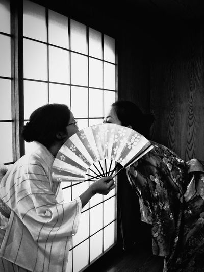 Japanese women holding folding fan at home