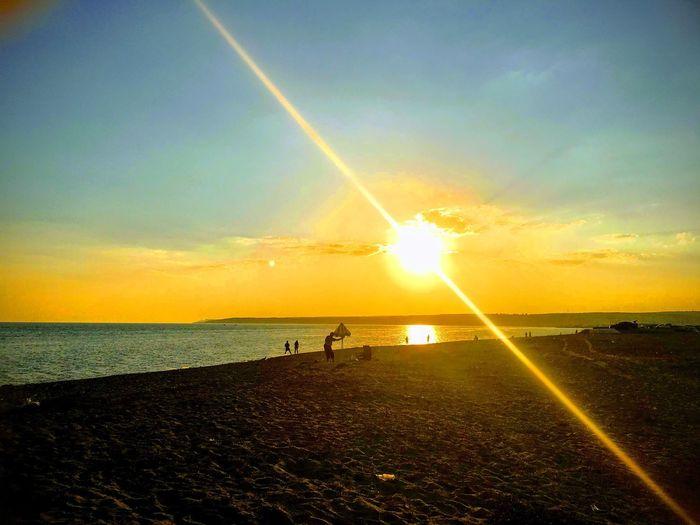 Sun Water Sky Sea Beach Land Sunset Beauty In Nature Sunlight