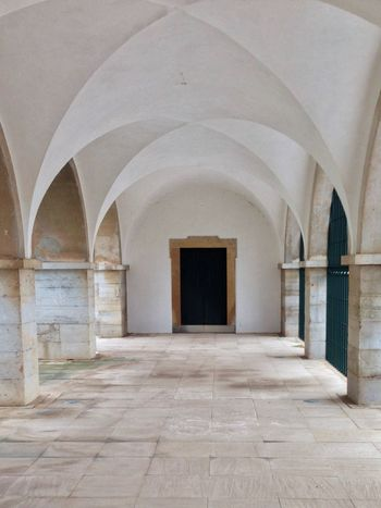 Cathedral cloister in Faro Arch Architecture Archway Building Building Exterior Built Structure Calm Ceiling Church Cloister Corridor Corridors  Door Entrance Flooring History Indoors  Interior Place Of Worship Religion Spirituality The Way Forward White Color