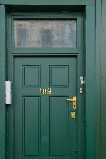 EyeEm EyeEm Best Shots EyeEm Selects Architecture Building Building Exterior Built Structure Closed Communication Day Door Entrance Full Frame Green Color House No People Number Outdoors Protection Safety Security Text Turquoise Colored Wood - Material