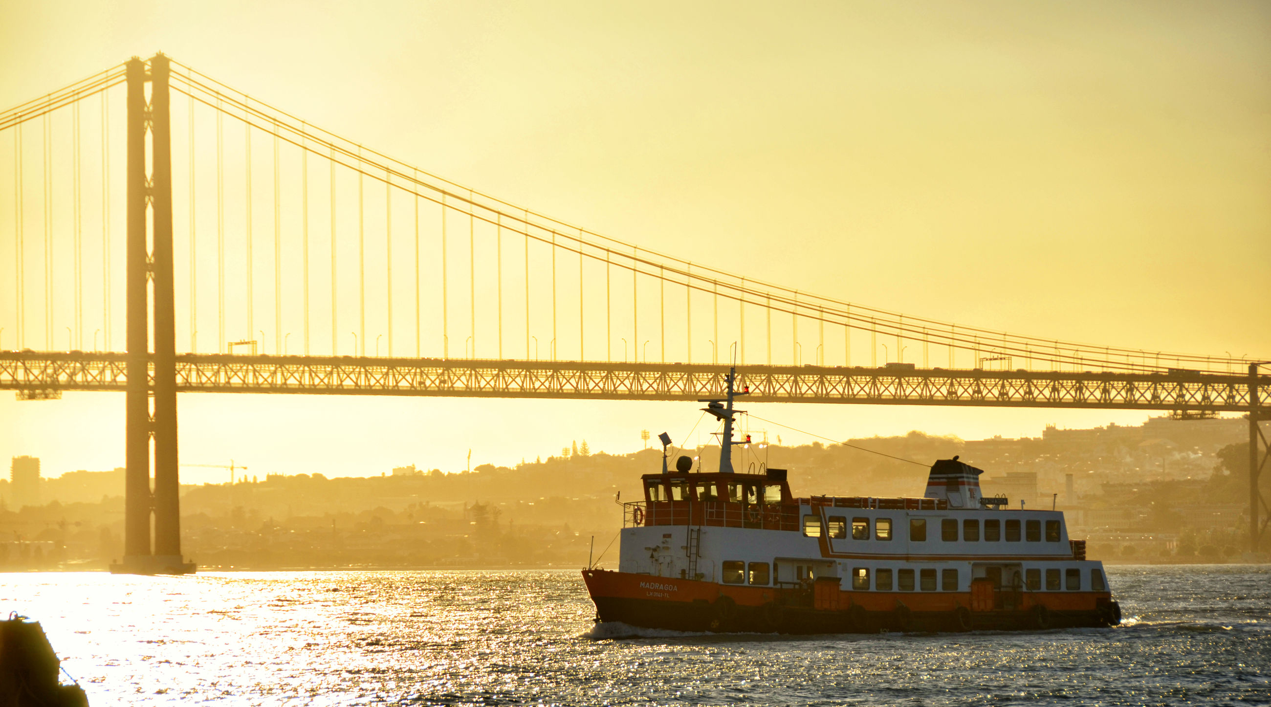 transportation, bridge - man made structure, nautical vessel, mode of transport, built structure, connection, water, clear sky, suspension bridge, architecture, river, travel, travel destinations, copy space, outdoors, waterfront, sky, nature, freight transportation, no people, city, day, industry, cityscape