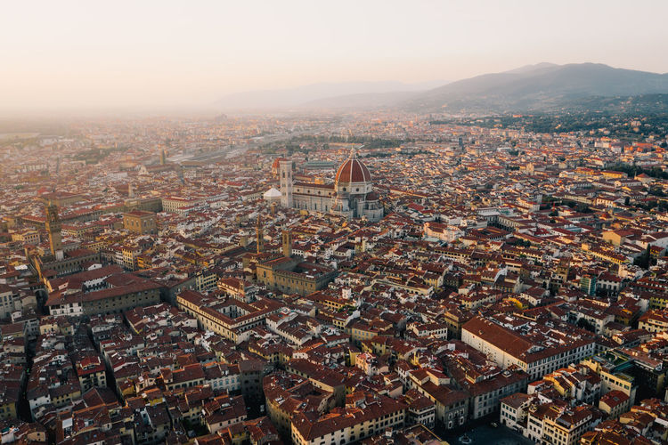The Duomo sitting high and mighty amongst the maze of streets in Florence. Duomo Aerial View Architecture Building Building Exterior Built Structure City Cityscape Community Crowd Crowded Dji Florence High Angle View House Italy Nature Outdoors Residential District Roof Sky Town TOWNSCAPE Travel Destinations Week On Eyeem A New Perspective On Life