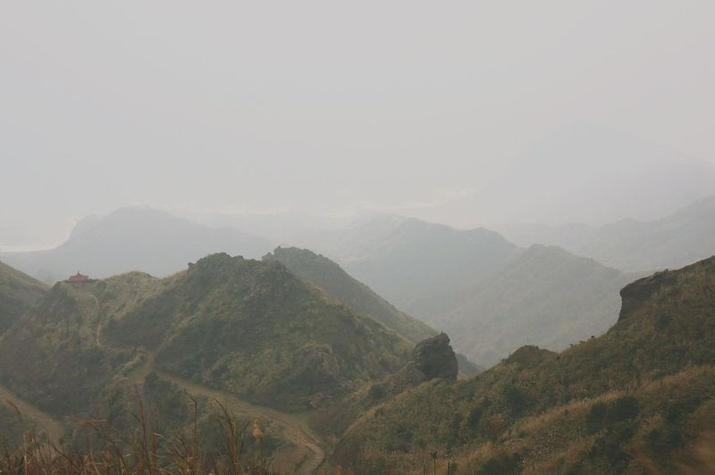 Idyllic Shot Of Mountain Range In Foggy Weather