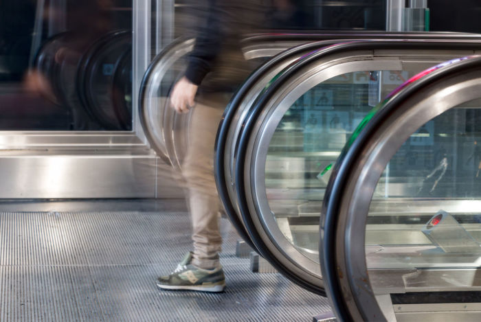 Escalator with blurry man Blurred Motion Circle Day Escalator Human Leg Indoors  Low Section Motion Waling Around