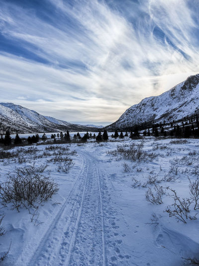 trail towards the valley Beauty In Nature Canada Cloud - Sky Clouds And Sky Cold Temperature Day Frozen Landscape Landscape_Collection Landscape_photography Mountain Nature No People Outdoors Path Scenics Sky Snow Snowcapped Mountain The Way Forward Trail Wilderness Area Winter Yukon Territory