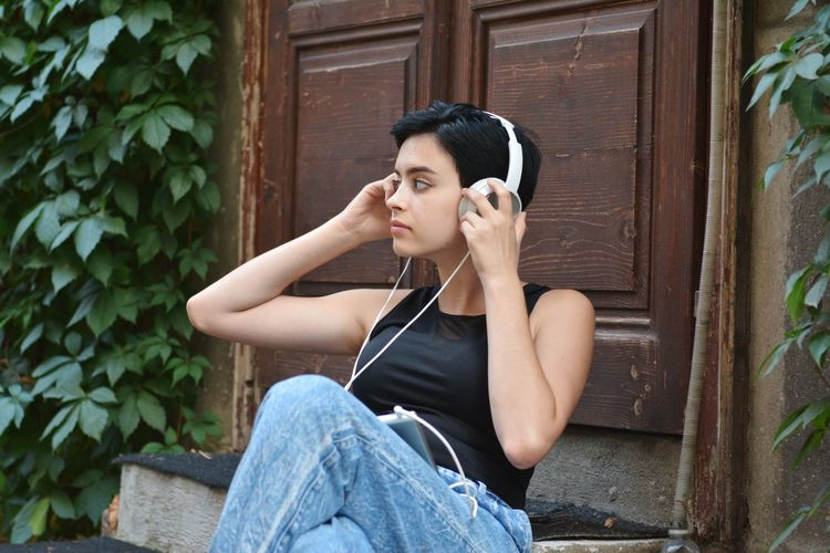 Ph: Mikko Hietanen Photography Photo People Girl Model Black Hair Short Hair Shorthair Green Color Portrait Silhouette Leaf Leaves City Sitting Music Men Headphones Listening Arts Culture And Entertainment In-ear Headphones Relaxation Tank Top Audio Equipment Plant Life Leaf Vein