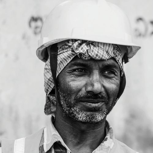 Close-up of mature man wearing hardhat