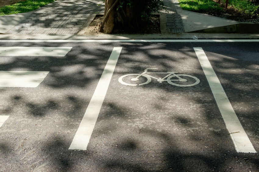 Asphalt Bicycle Lane Close-up Day Guidance High Angle View No People Outdoors Road Road Marking Road Sign Street Transportation
