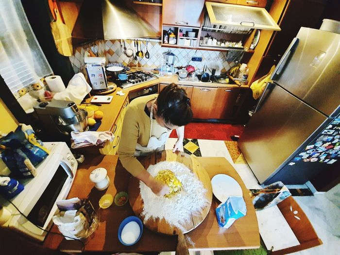 High angle view of people working in kitchen