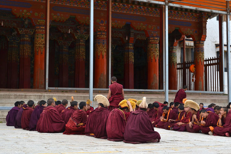 Group of monks outside temple