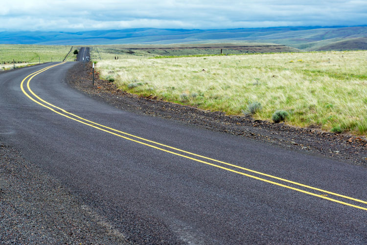 Asphalt Central Oregon Day Dividing Line Empty Grass Highway Landscape Nature Nature No People Oregon Outdoors Pacific Northwest  Road Sky The Way Forward Tourism Transportation Travel Travel Destinations USA Winding Road