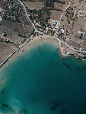 Aerial photo of a Mediterranean Coastline Aerial View High Angle View Environment Landscape Land Nature Day Water Scenics - Nature Industry Outdoors Travel Destinations No People Mediterranean  Sea Beach Coastline Coast Road Coastal Drone Photography Ocean Arid Climate Greece Paros