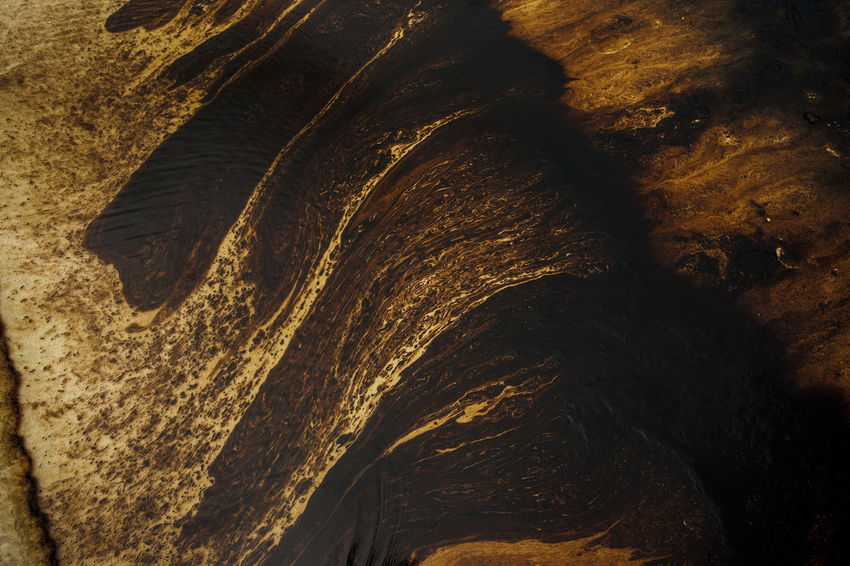 Texture of Crude oil spill on sand beach from oil spill accident Colors Wave Beach Nature No People Oil Spill Oil Spill Beach Oil Spill Sea Sea Texture Water