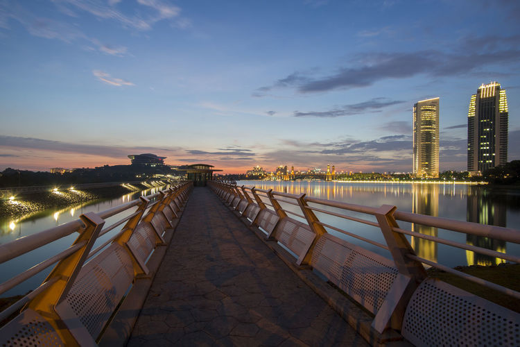 Scenery of main dam in Putrajaya with sunset background Waves 43 Golden Moments Architecture Blue Bridge Built Structure City City Life Cloud Cloud - Sky Diminishing Perspective Dusk Exterior Government Illuminated Landmarks Nature No People Outdoors Sky Sunset The Way Forward Urban Vanishing Point Water