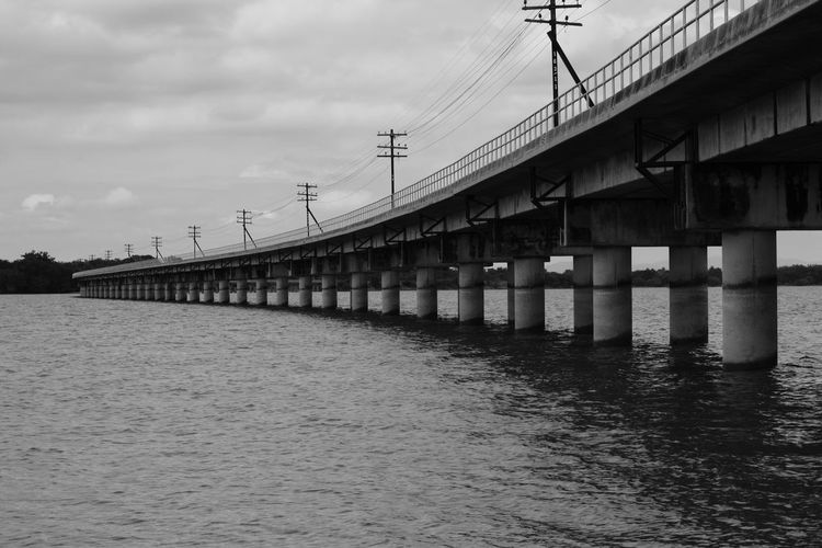 Built Structure Architecture Sky Connection Water Cloud - Sky Bridge Waterfront Nature Building Exterior No People Beach Architectural Column Bridge - Man Made Structure Sea Flock Of Birds Day Outdoors Land Pier