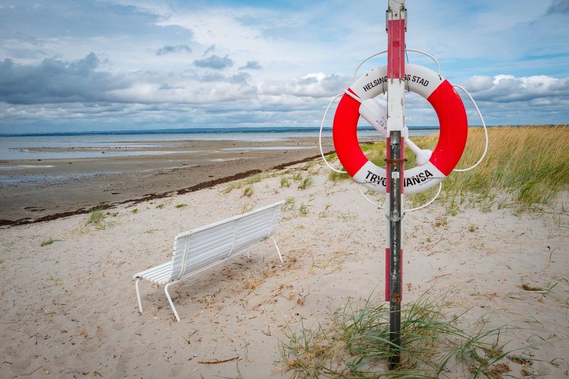 Lifebuoy and bench Bench Lifebuoy Sky Land Cloud - Sky Beach Sand Water Nature Scenics - Nature Outdoors Sea