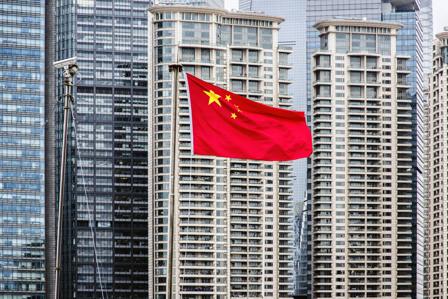 Chinese Flag Architecture City Cityscape Day Flag No People Outdoors Patriotism Red Skyscraper
