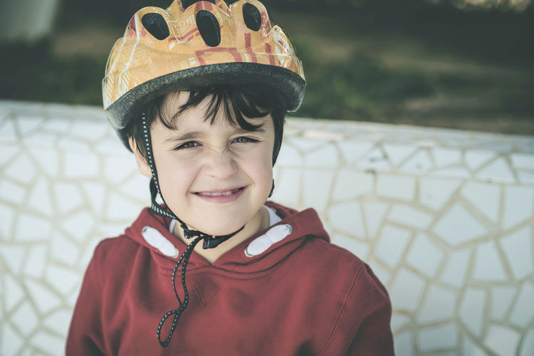 Portrait of smiling boy wearing helmet