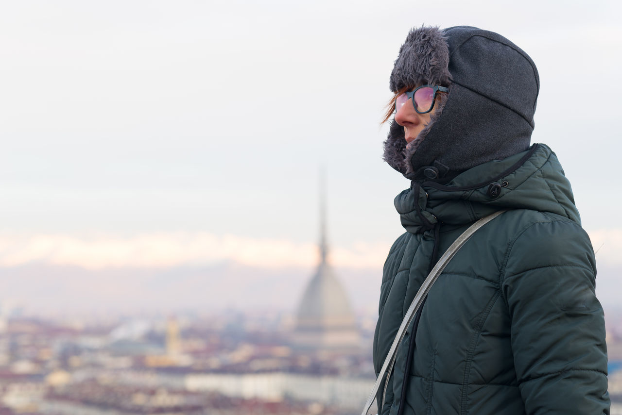 Woman Wearing Winter Coat With Mole Antonelliana In Background