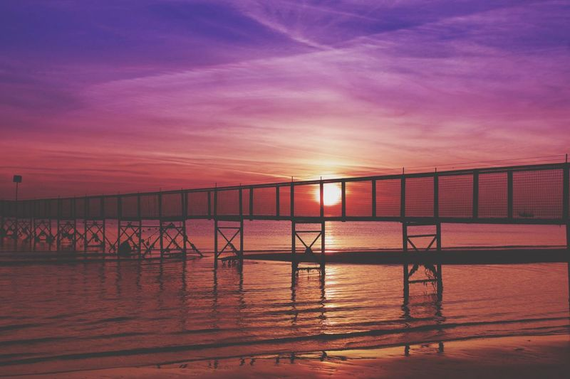 Sunrise Pier Travel Travel Destinations Water Sky Sunset Bridge Scenics - Nature Nature Cloud - Sky Bridge - Man Made Structure Tranquil Scene Connection Built Structure Transportation Tranquility Architecture Sea Reflection Beauty In Nature No People Outdoors