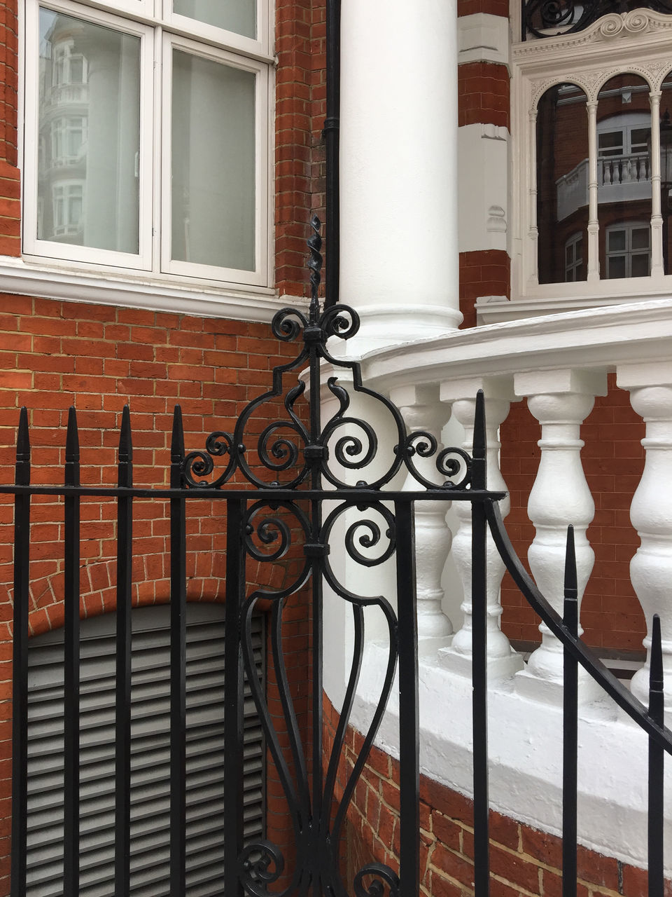 architecture, building exterior, railing, built structure, house, staircase, wrought iron, entrance, window, gate, residential building, design, steps, door, steps and staircases, outdoors, no people, day, close-up, city