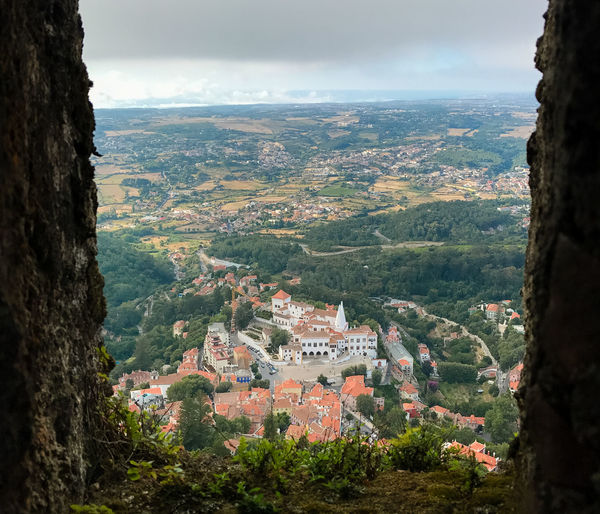 Sintra from above Sintra Architecture Beauty In Nature Building Exterior Built Structure Cliff Day Landscape Mountain Nature No People Outdoors Palacio Nacional De Sintra Scenics Sky Tranquility Travel Destinations Tree