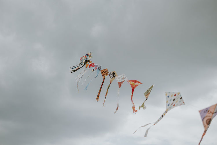 Fusion Festival Kite Celebration Cloud - Sky Flying In A Row Kite Flying Low Angle View Multi Colored No People Sky Wind