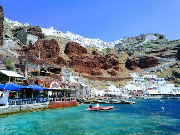 Santorini Water Nautical Vessel Sea Beach Blue Day Vacations Outdoors Nature No People Beauty In Nature Tree Sky