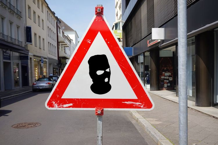 Hood Sign Communication Triangle Shape Road Road Sign Transportation City Built Structure Shape Representation Red Architecture Human Representation Warning Sign Day Building Exterior Guidance Street Information Sign Outdoors