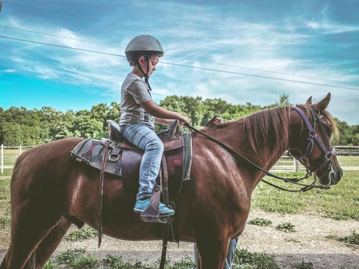 Boy riding horse