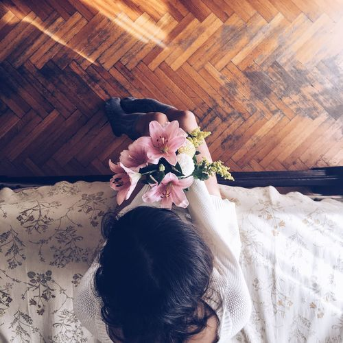 Directly above shot of woman holding flower bouquet