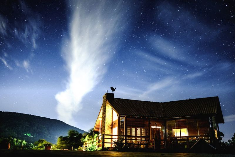 House Star - Space Sky Night Astronomy Milky Way Long Exposure Built Structure Star Field Building Exterior Architecture Scenics Galaxy Nature Outdoors Illuminated Beauty In Nature Low Angle View No People Constellation Cloud - Sky House The Great Outdoors - 2017 EyeEm Awards
