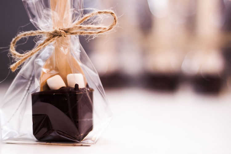 Close-up of wrapped chocolate on table