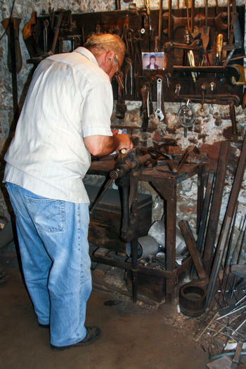 Adult Adults Only Craftsperson Day Full Length Indoors  Instrument Maker Making Men Metal Industry Occupation One Man Only One Person Only Men People Real People Side View Skill  Working Workshop