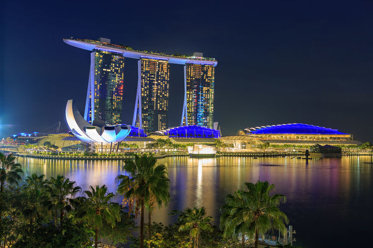 Marina Bay Sands Hotel of Singapore town by night, Singapore. City, Marina Bay Sands Hotel, Panorama, Singapore, Architecture, Asia, Bay, Building, Business, Cityscape, District, Dusk, East, Evening, Famous, Hotel, Illuminated, Landmark, Landscape, Light, Marina, Modern, Night, Reflection, Sea, Skyline, Skyscrapers, Architecture Beauty In Nature Blue Building Exterior Built Structure City Cityscape Illuminated Modern Nature Night No People Outdoors Plant Reflection Sky Travel Destinations Tree Water