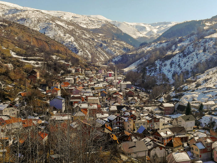 High angle view of townscape and mountains