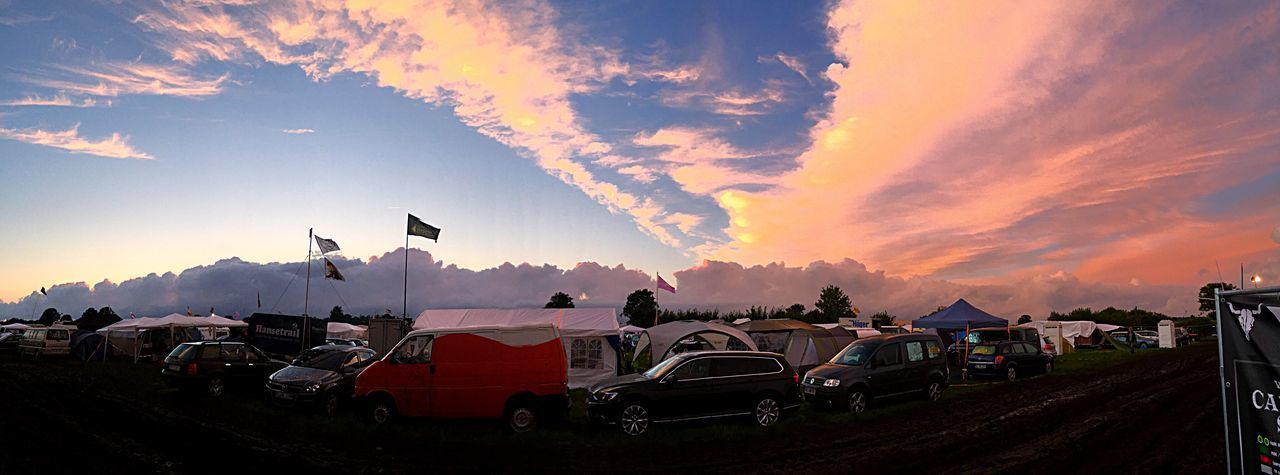 Wacken 2016 No Filter, No Edit, Just Photography Sunset Open Space Festival Bands Found Love First Time Working WackenOpenAir2016 Sky Sunset Transportation Mode Of Transportation Cloud - Sky Car Motor Vehicle City Orange Color Dusk Panoramic Outdoors