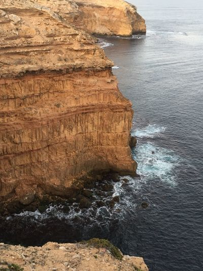 High angle view of rock formations by sea at innes national park