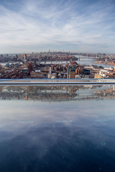 Brooklyn Reflecting Brooklyn Exploring New York New York City Reflection Rooftop Architecture Beauty In Nature Building Exterior Built Structure Climbing Cloud - Sky Cold Temperature Day Ice Rink Landscape Nature No People Outdoors Reflections Rooftopping Sky Skyscraper Urban Water